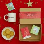 Scatola di Natale MSF con tazza, tisana e tavoletta di ciocccolata